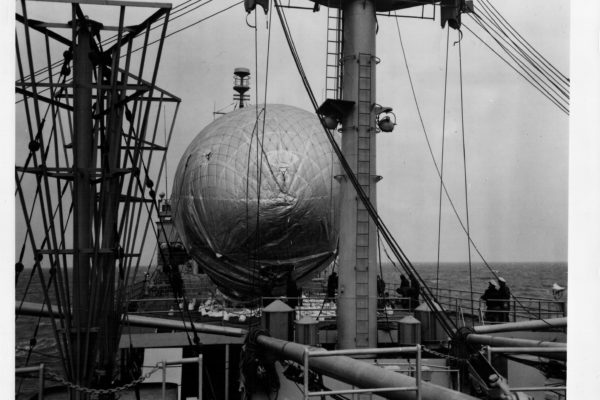 Captive balloon supports a Voice of America antenna on USCGC Courier. October 1952 U.S. Coast Guard photo.
